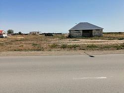 Земельный участок с недостроенным домом Атырау