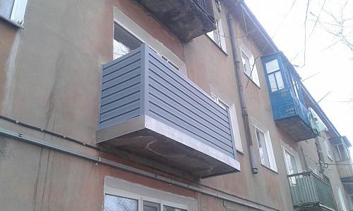 Обшивка балкона сайдингом Караганда